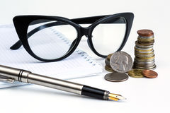 Pen, coins and glasses business Royalty Free Stock Photography