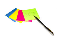 Pen and colored papers with the inscription. Of the numerals of the New year Royalty Free Stock Photos