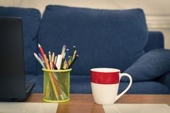 Pen with colored pencils royalty free stock image