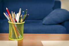 Pen with colored pencils stock photography