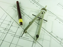 Pen & Compass. Pen and drawing compass sitting on engineering beam design drawings Stock Photo