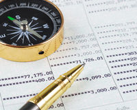 Pen and compass on bank account book Stock Image