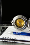 Pen and compass on notebook laptop Royalty Free Stock Photos