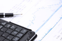 Pen computer and chart Stock Photo