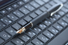 Pen On Computer Keyboard Stock Photo