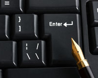 Pen in computer keyboard Stock Photos