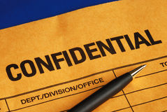 Pen on the confidential envelope. Isolated on blue Stock Photos