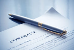Pen on contract papers stock photography