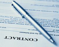 Pen on contract papers stock images