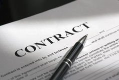 Pen on contract papers royalty free stock images