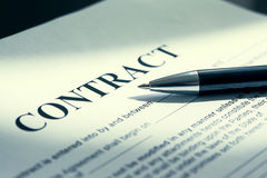 Pen on contract papers royalty free stock photography