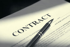 Pen on contract papers Stock Image