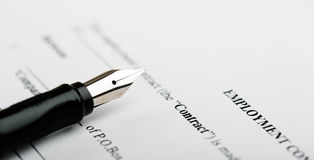 Pen on contract papers Stock Photos