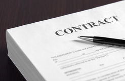 Pen on the contract papers royalty free stock photo