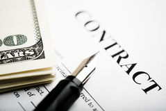 Pen on contract papers and us dollars Stock Images