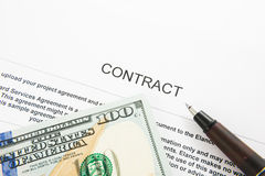 Pen on the contract papers and us dollars Royalty Free Stock Photos