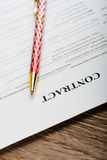 Pen on the contract papers Stock Photography