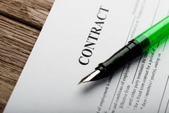 Pen on the contract papers Stock Images