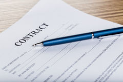Pen and contract papers Stock Photo