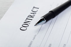 Pen and contract papers Stock Image