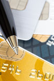 Pen on credit cards Stock Image