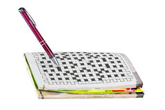 Pen and crossword Stock Images
