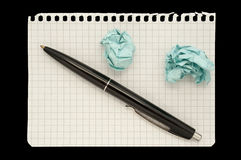 Pen and crumpled papers Royalty Free Stock Image