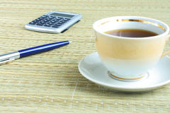 Pen and cup of coffee Stock Photo