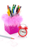 Pen cup and crayon. Pink pen cup in the crayon with alarm clock. Education concept stock images