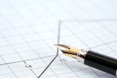 Pen On Diagram Stock Photo