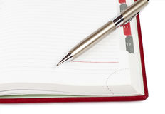 Pen on a diary. Isolated on a white Royalty Free Stock Photos