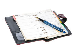 Pen and diary. Fountain pen and diary on white background Royalty Free Stock Photos