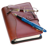 Pen and diary. Fountain pen and diary on white background Royalty Free Stock Images