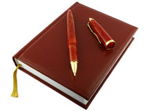 Pen and diary. It is isolated on a white background. A close up Royalty Free Stock Image