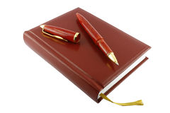 Pen and diary. It is isolated on a white background. A close up Royalty Free Stock Photos
