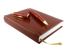 Pen and diary. It is isolated on a white background. A close up Stock Photos