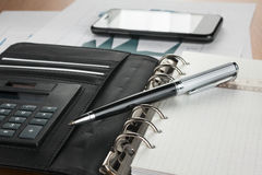 Pen on diary on the background of  phone Stock Photo