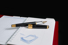 Pen on diary book Stock Photo