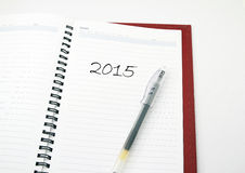 Pen on a 2015 diary. A pen on diary on isolated white background Royalty Free Stock Photos