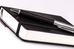 Pen and diary or planner on white Royalty Free Stock Image