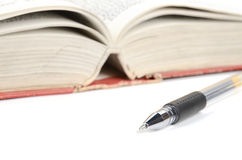 Pen and dictionary Stock Photos