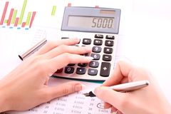 Pen, digits and calculator Stock Photos