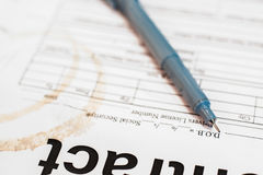 Pen on dirty paper close-up, business background Stock Photos