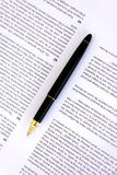 Pen on a document closeup Stock Images