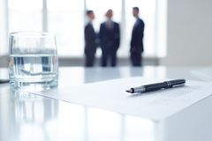 Pen on document and glass of water Royalty Free Stock Image