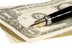 Pen on dollar bills Stock Photography