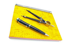 Pen and drawing compass on notebook Royalty Free Stock Photos