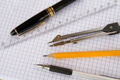 Pen and drawing needs. School pen and drawing needs spanning on book Royalty Free Stock Photo