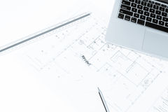 Pen, drawing rulers, and notebook over house construction bluepr Stock Photo