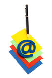 Pen with email symbol on a pile of cards Stock Photo